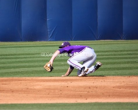 SS Keaton Jones makes a sliding stop in the hole.