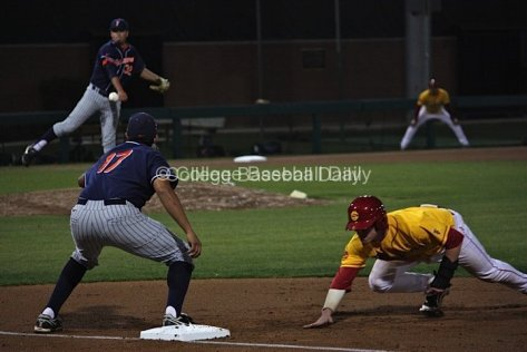Koby Gauna fires to first trying to get Adam Landecker.