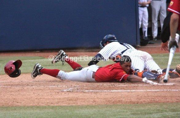 Dante Flores slaps the plate.