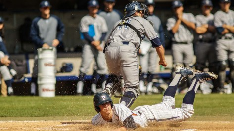 Hutton Moyer splashes across home plate with a run. (Photo: Mark Alexander)