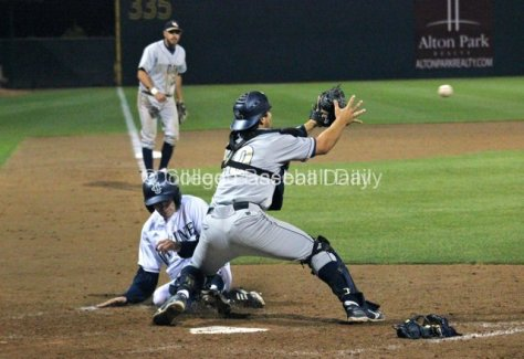 Justin Castro slides in as Izaak Silva blocks the plate.