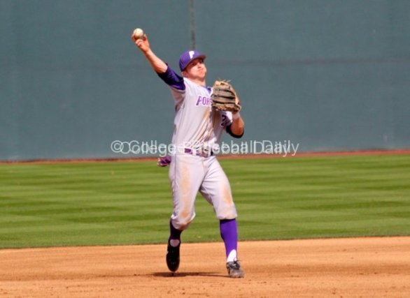 Jeff Melby tries to throw out a batter.