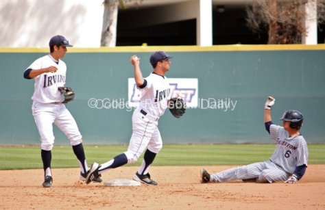 D.J. Crumlich takes it himself to turn the double play.