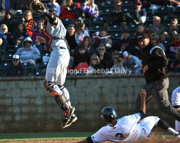 Chad Wallach climbs the ladder to catch a relay throw.