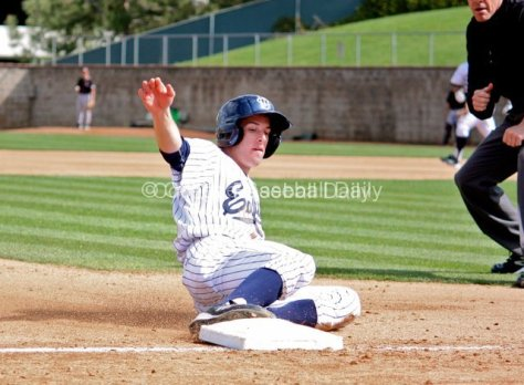 Dillon Moyer slides into third base.