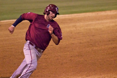Tanner Donnels rounds third.