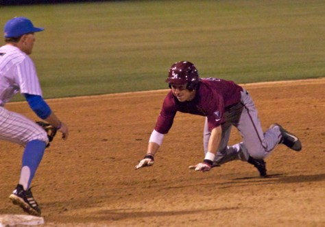 Austin Miller dives into third.