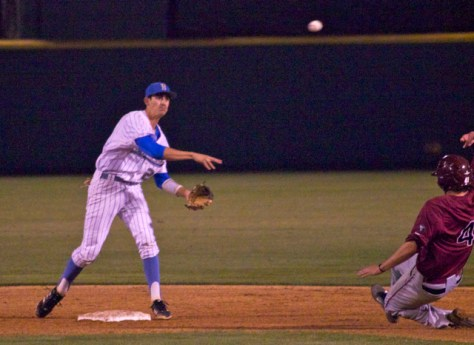 Luke Persico turns a double play.