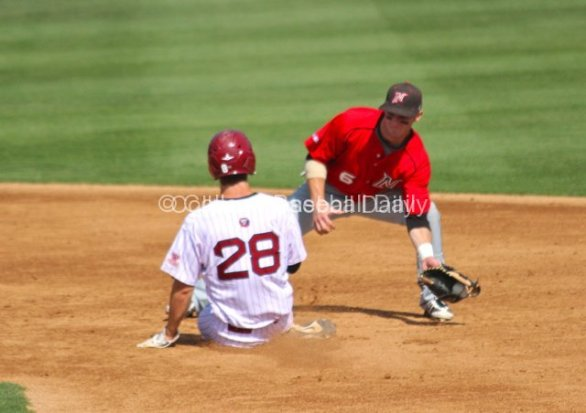 Kyle Attl tries to apply the tag.