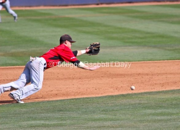 A ball is just out of the reach of a diving Kyle Attl.