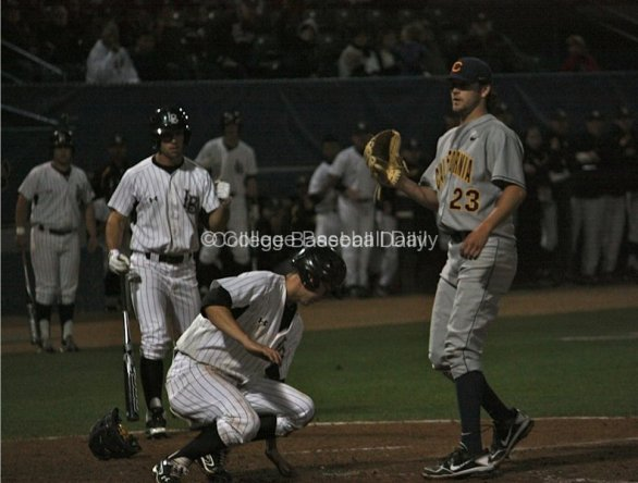 A Dirtbag scores on a wild pitch from Justin Jones.