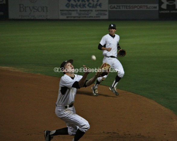 Jeff Yamaguchi runs down a popup with an over-the-shoulder catch.