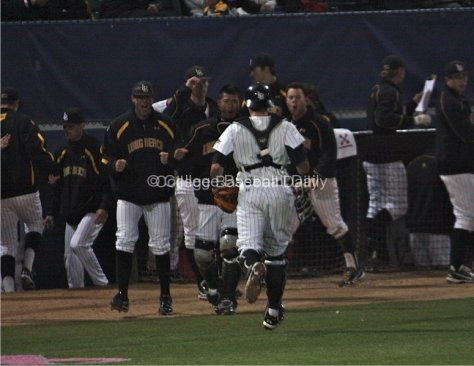 The dugout is pumped after Long Beach escapes a jam.