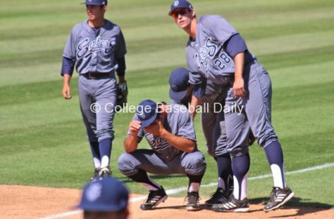 Evan Brock is consoled by teammates.