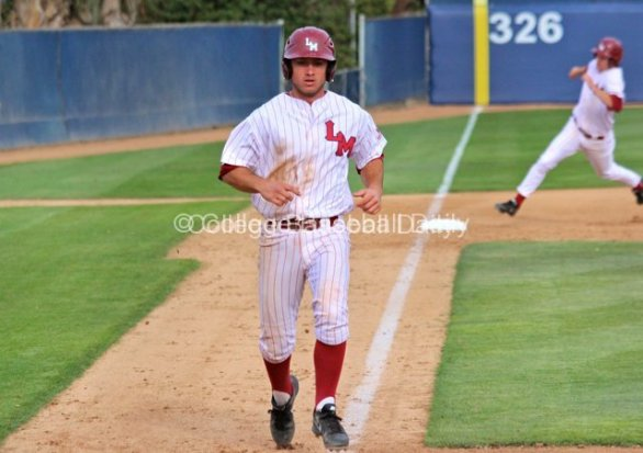 Tommy Cheek scores as another runner chugs around third base.