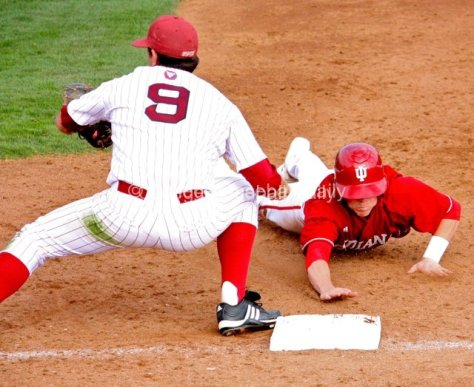 Chad Clark dives back to first base.