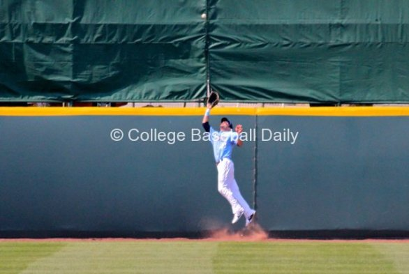 Louie Lechich makes a leaping catch at the wall.
