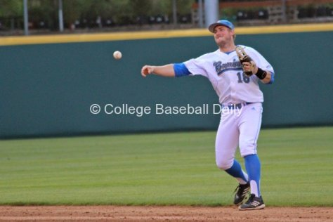 Cody Regis throws to first.