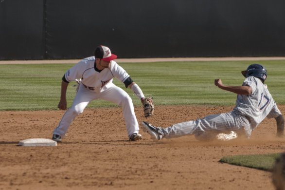 Michael Livingston applies the tag to Carlos Lopez.