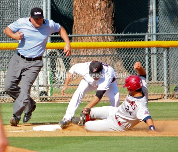 Colton Plaia is tagged out by Matt Moreno.