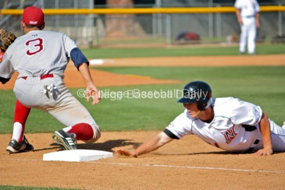 Todd Eskelin dives back into first.