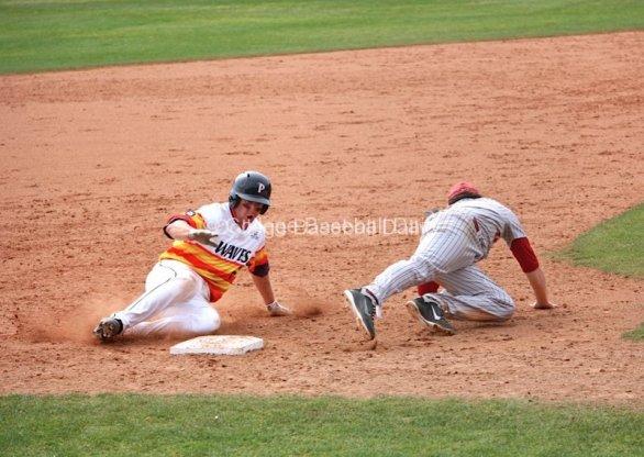 Miles Silverstein slides into third base