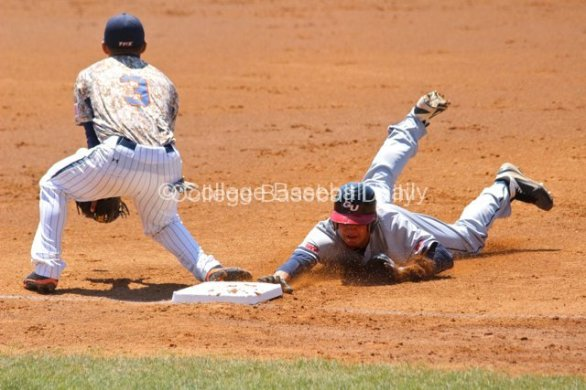 Alex Bonczyk dives into third base.