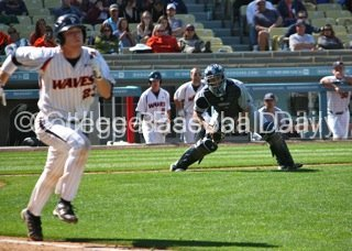 Chris Rabago fields a bunt.