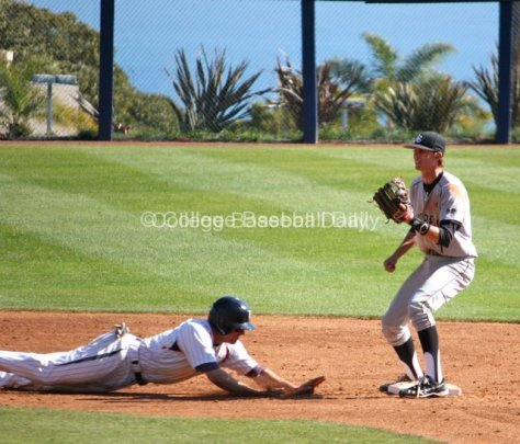 Miles Silverstein dives back into second base.