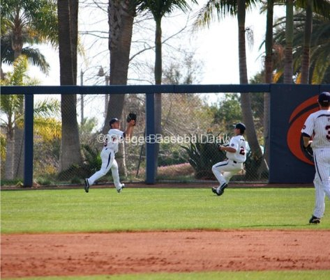 Tony Cooper ranges to left-centerfield for the putout