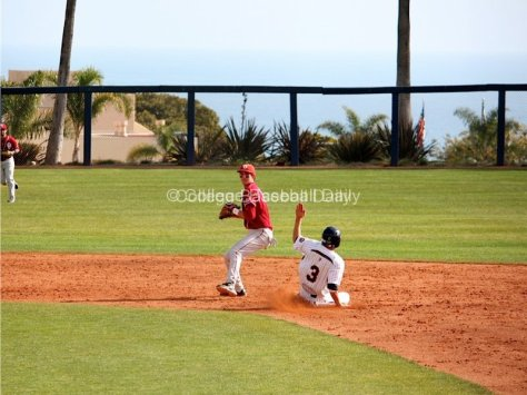 Dustin Dishman attempts to turn a double play