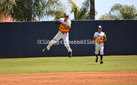 Zach Vincej tries to make a jump throw in the hole.