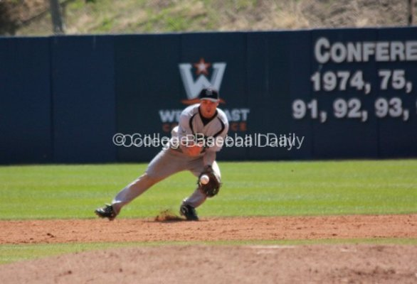 Jason Mahood fields a grounder at second base.