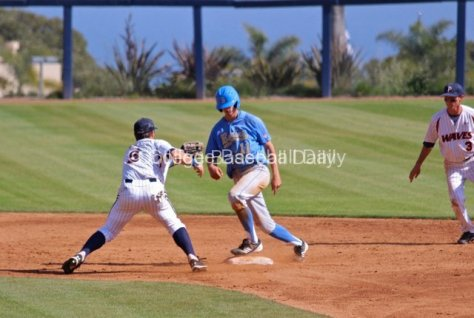 Trevor Brown avoids the tag on a pick off.
