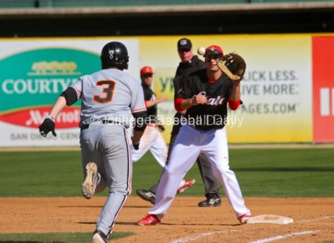 Jonathan Spirk catches a dropped third strike from the catcher.