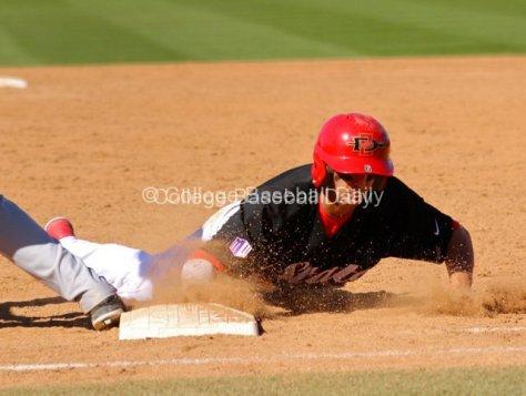 Steven Pallares dives back into first base.