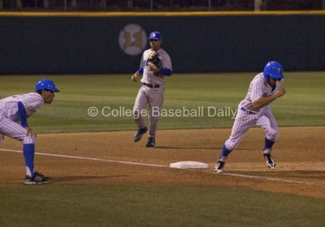 Brian Carroll tags from third base.