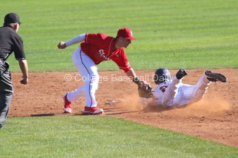 Aaron Brown gets in just under Jarred Mederos tag. (Photo: Shotgun Spratling)