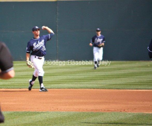Jordan Fox fields a grounder at 2B.