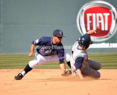 D.J. Crumlich applies the tag.