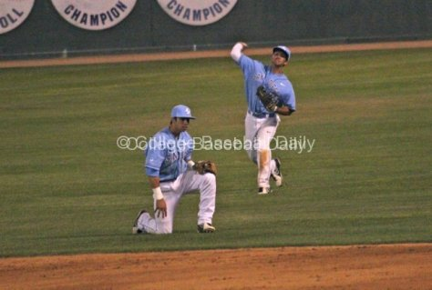 AJ Robinson throws home late.
