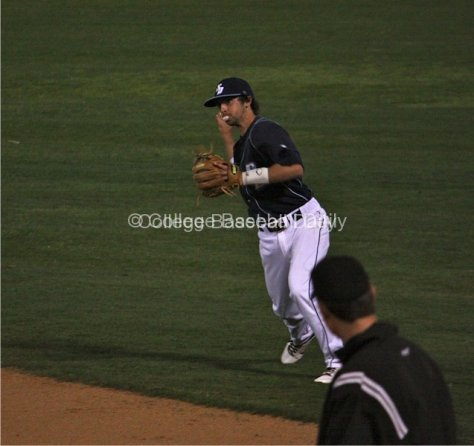 2B Austin Bailey blows a bubble as he makes a play