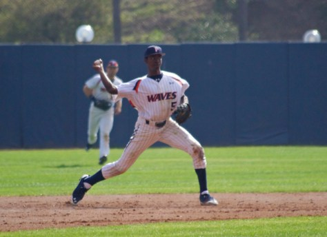 Manny Jefferson throws to first.