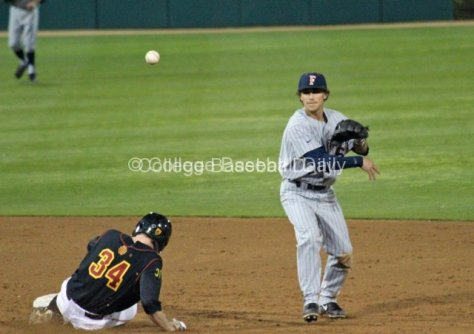 Richy Pedroza turns the double play.
