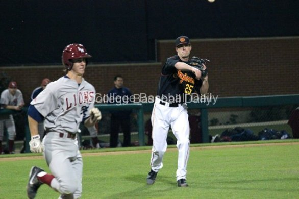 Brent Wheatley throws to first base.