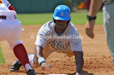 Brenton Allen dives back to first base.
