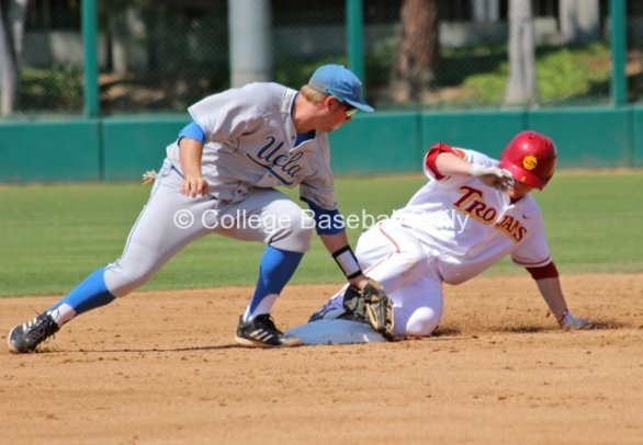 Adam Landecker slides in before Cody Regis can apply the tag.