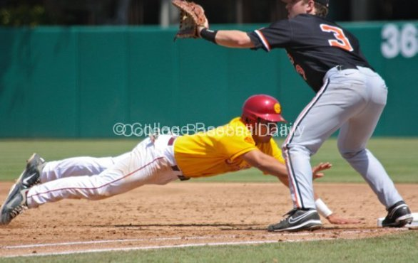 Andres Rodriguez dives back to first.