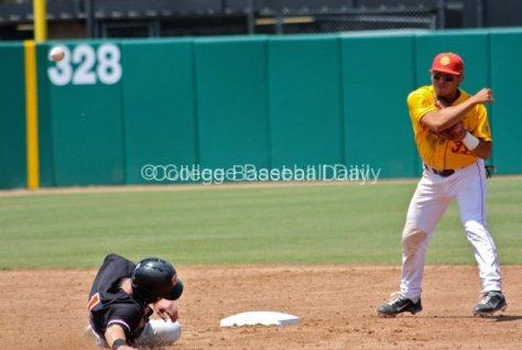 Andres Rodriguez turns a double play.