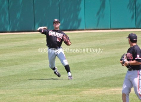 Dylan Davis tries to throw out a runner at the plate.